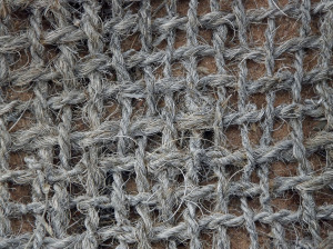 Burlap fabric showing the criss crossing weave of the thread.